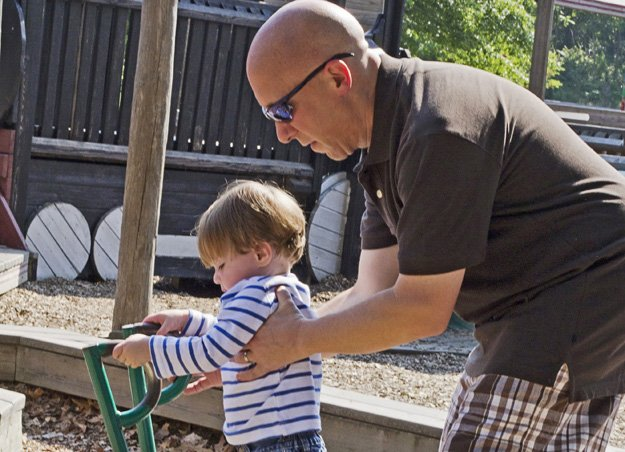 Eighteen-month-old Parker Swearingen is learning that dads and moms can be caregivers. Part of Michael's routine is taking Parker to the playground.