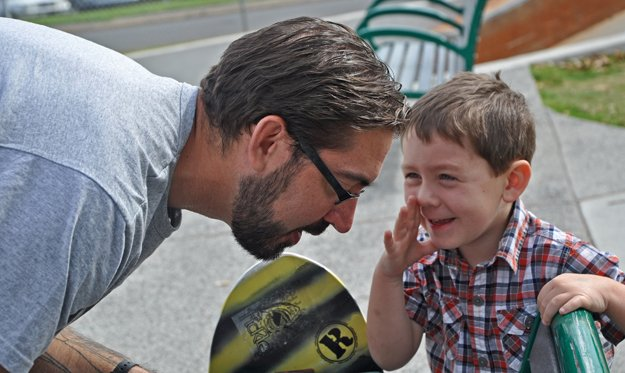 Wrtiter David Thornton works on the finer points of skateboarding with his son, Jackson, at the new Tobey Park.