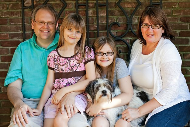 Our family: John (digital communications manager at Youth Villages), Marci (self-employed portrait photographer), Margret (11), Audrey (9), and dog Lexi.