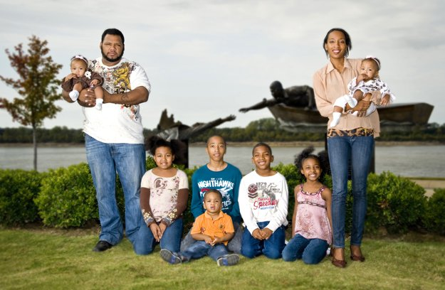 (Right to left): Writer Telika Howard holds Keziah (10 mos.). Sitting beside her is Xaria (8), 	Montrell (13), Elijah (2), Adam (9), and Tayina (11). Husband Xavier holds the older twin, 
