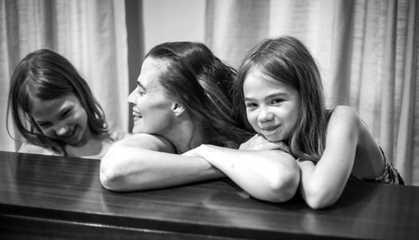Barger loves playing with perspective. Pictured here with daughters Sage & Maeve.