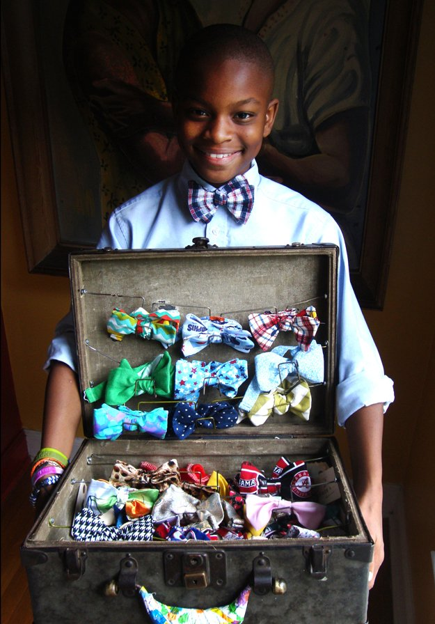 Mo's suitcase filled with colorful bow ties. Pictured with his mom, Tramica Morris.