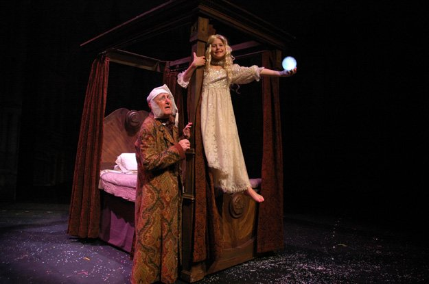 Scrooge and Past: Barry Fuller (l) as Scrooge and Alessandra as Ghost of Christmas Past in a recent production of  A Christmas Carol at Theatre Memphis