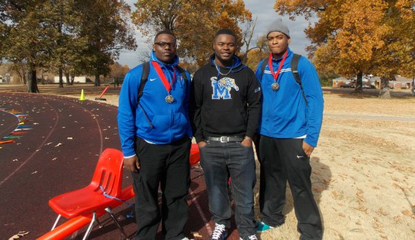 Karl Chambers, Jr. (middle) returned to East High students to support kids in the HKT marathon program.