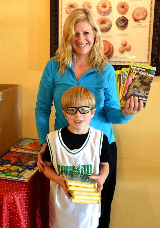 Lending a hand for Little Helpers are Penny Glidewell and her son, Davis