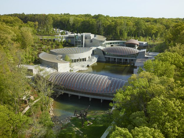 Aerial view of Crystal Bridges Museum of American Art, designed by Safdie Architects; photography by Timothy Hursley. Courtesy of Crystal Bridges Museum of American Art, Bentonville, Arkansas.